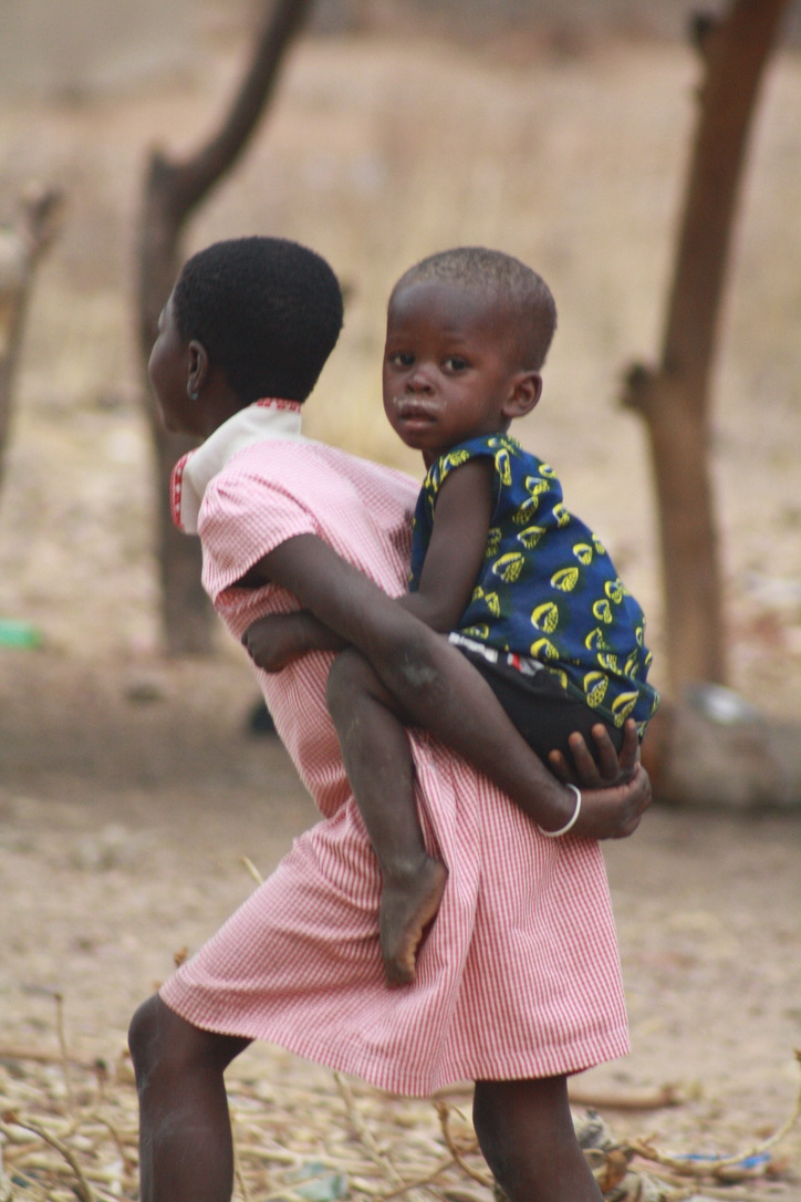 Feeding Our Family Burkina Faso 2018 child on back of another child